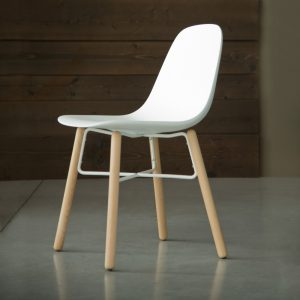 Jane Hamley Wells BABETTE_BABW_A modern café restaurant side chair molded polyurethane seat on wood legs with contrasting metal stretchers