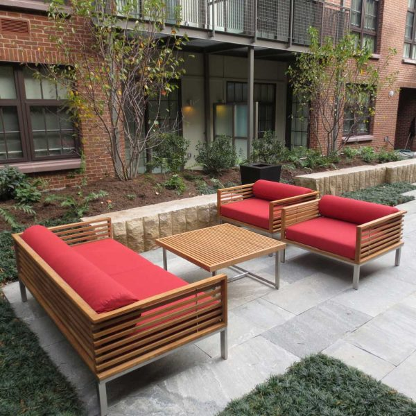 Jane Hamley Wells BEO_BO5999 modern indoor outdoor 2-Arm sofa teak stainless steel legs upholstered cushions lifestyle_1
