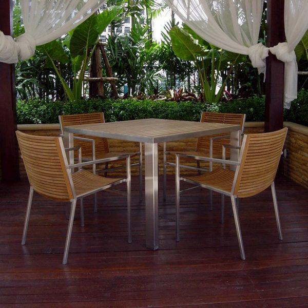 Jane Hamley Wells TAJI_TJ8545_Lifestyle_1 modern outdoor square dining table teak top stainless steel legs